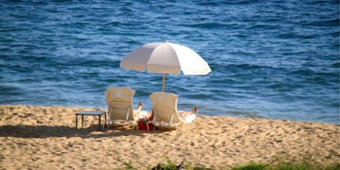 photo of sunbathers on the beach on Lanai at Four Seasons Manele Bay